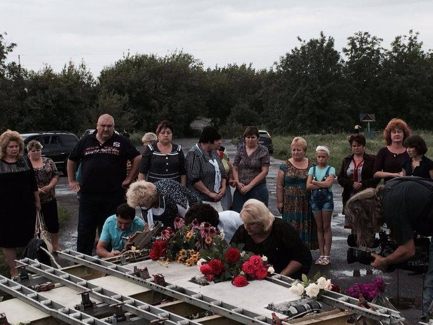 Local residents mourning the dead from MH17, which fell down on their village. Photo: BBC