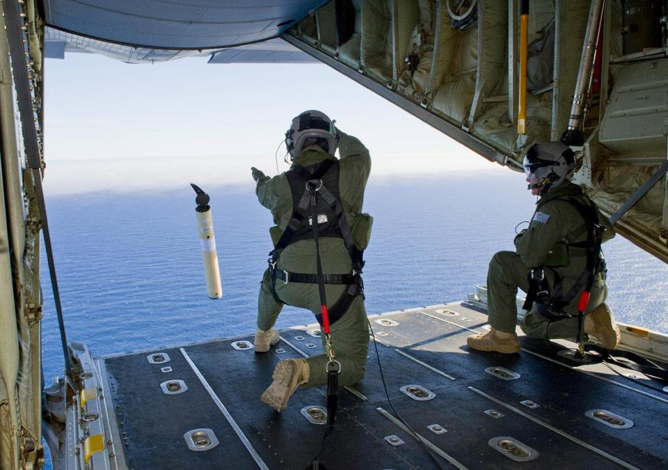 In this March 20, 2014 file photo provided by the Australia Defence Department, Royal Australian Air Force Loadmasters launch a Self Locating Data Marker Buoy from a C-130J Hercules aircraft in the southern Indian Ocean for search of missing Malaysia Airlines plane, flight MH370