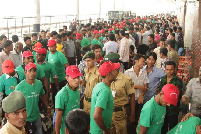 Bangladeshi migrant workers arrive at the airport to clear procedures before boarding flights to foreign destinations.  Photo: Star/file