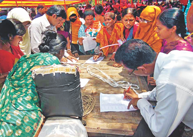 Teachers signing attendance sheets at the venue of a reception programme for State Minister for Fisheries and Livestock Narayan Chandra Chanda at Dumuria of Khulna yesterday. This was done to make sure that teachers of over 200 schools joined the reception programme. Photo: Star
