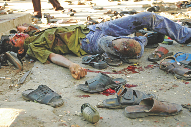 An unexploded grenade among shoes and a body on Bangabandhu Avenue right after the carnage on August 21, 2004.  Photo: File