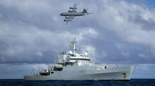 A Royal Australian Air Force (RAAF) AP-3C Orion aircraft flies past the British naval ship HMS Echo in the southern Indian Ocean as they continue to search for the missing Malaysia Airlines flight MH370 in this handout picture released by the Australian Defence Force April 15. Photo: Reuters