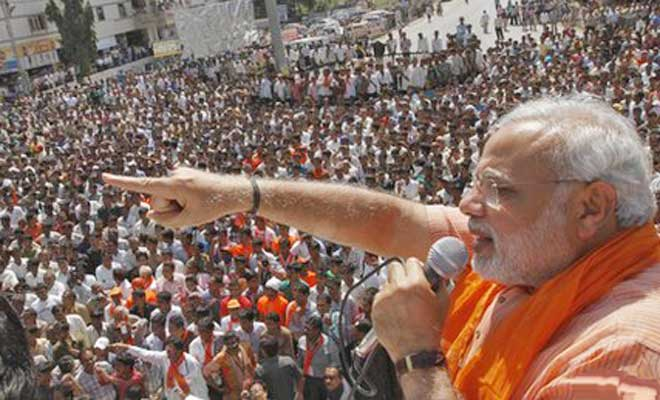 This STAR file photo shows Narendra Modi speaks to a mass gathering at Kerala, India, before Lok Shava polls