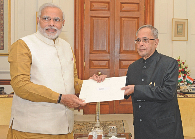 President Pranab Mukherjee hands over the letter of appointment as PM to Narendra Modi at Rashtrapati Bhavan in New Delhi yesterday, inviting the BJP leader to form the next government. Photo: Press Information Bureau, India