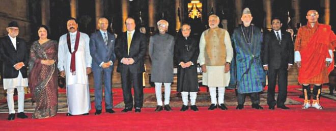 Jatiya Sangsad Speaker Shirin Sharmin Chaudhury, second from left, with the leaders of Saarc countries and new Indian Prime Minister Naredra Modi, fourth from right, and Indian President Pranab Mukherjee, fifth from right, after the swearing-in ceremony for Modi at the Rastrapati Bhavan in New Delhi yesterday. Photo: courtesy