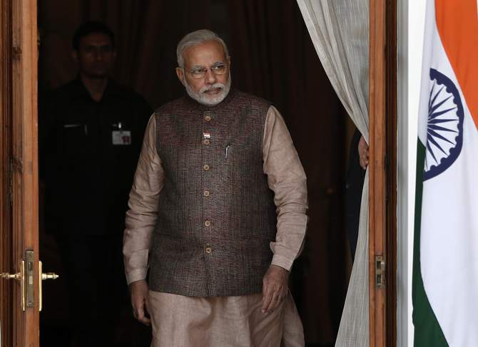 India's Prime Minister Narendra Modi comes out of a meeting room to receive his Bhutanese counterpart Tshering Tobgay before the start of their bilateral meeting in New Delhi May 27. Photo: Reuters