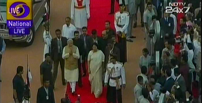 India's PM designate Narendra Modi is greeted as he reaches the Rastrapati Bhaban to take oath. Photo: TV grab