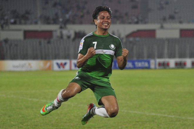 Team BJMC midfielder Abdullah Parvez celebrates his stunning 40-yard strike which helped his side beat Mohammedan in their Bangladesh Premier League match at the Bangabandhu National Stadium yesterday.  PHOTO: STAR