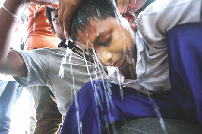 At one stage, Mohsin, one of the students demonstrating even in the scorching heat, fell sick and later was taken to a hospital. Photo: Palash Khan