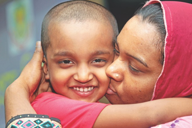 A relieved mother kisses her six-year-old son, Mizan, who was rescued 15 days after his kidnap on April 14, allegedly by the three men. Photo: Star