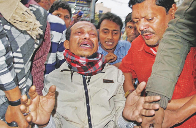 Mridul Kumar Chowdhury breaks down in tears as he is brought to a Chittagong private hospital after his rescue yesterday, six days after his abduction.   Photo: Star