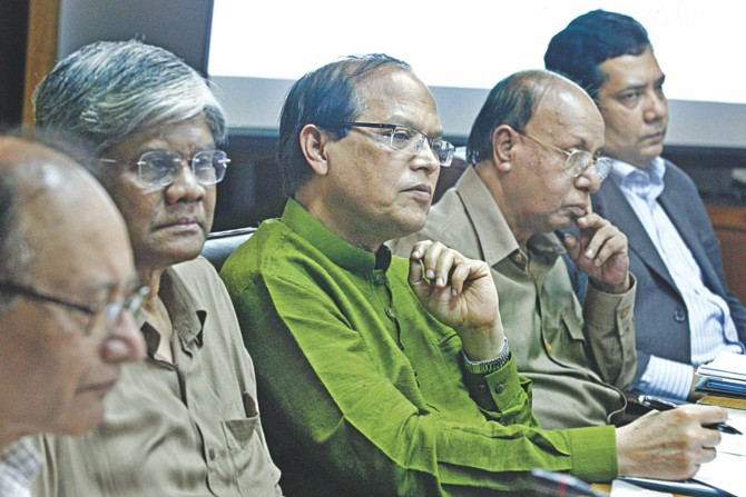 From left, Mustafa K Mujeri, director general of BIDS; Salehuddin Ahmed, a former central bank governor; Atiur Rahman, governor of Bangladesh Bank; AB Mirza Azizul Islam, former caretaker government adviser; and Monzur Hossain, senior research fellow of BIDS, attend a seminar on monetary policy in Dhaka yesterday. Photo: Star
