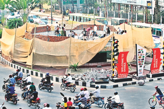 "A few hundred metres down the street, the pretty fountain at Bijoy Sarani intersection is being demolished to make way for a ""multi-colour musical fountain"". Photo: Anisur Rahman/File"