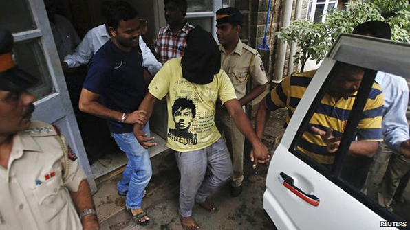 Five men, including a juvenile, were accused over the gang rape of the photojournalist