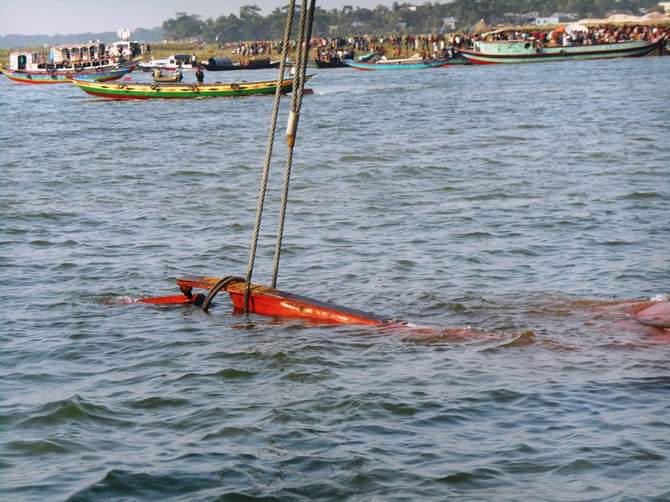 In this May 16 photo, a rescue vessel trying to pull the capsized launch MV Miraj-4 towards the shore of the Meghna in Munshiganj.