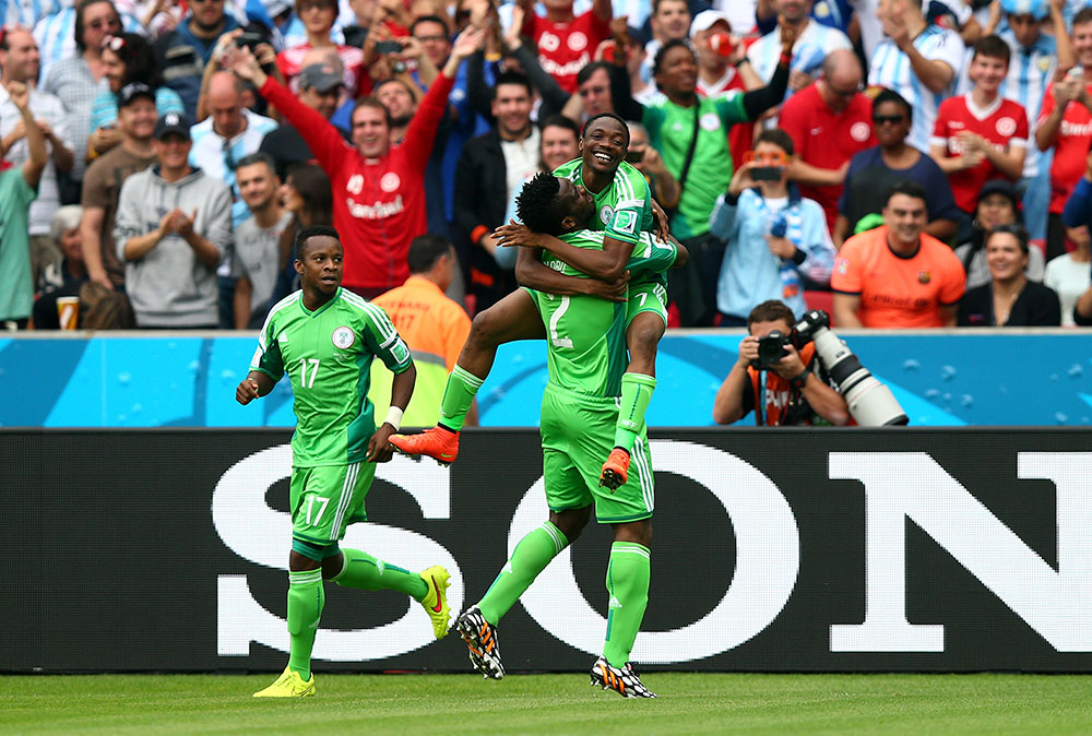 Ahmed Musa (R) of Nigeria celebates scoring his team's first goal with his teammates Joseph Yobo (C) and Ogenyi Onazi (L) during the 2014 FIFA World Cup Brazil Group F match between Nigeria and Argentina at Estadio Beira-Rio on June 25, 2014 in Porto Alegre, Brazil. Photo: Getty Images