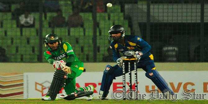 Bangladesh skipper Mushfiqur Rahim sweeps away a delivery in Mirpur stadium during 2nd ODI today. Photo: Firoz Ahmed