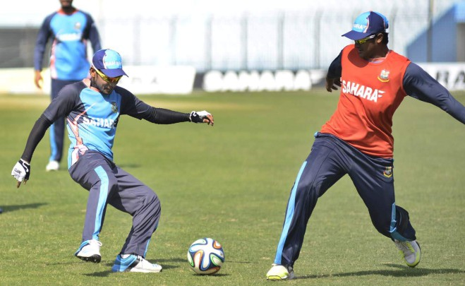 Bangladesh captain Mushfiqur Rahim (L) and all-rounder Shakib Al Hasan play a game of football as part of their training at the Zohur Ahmed Chowdhury Stadium in Chittagong yesterday. Photo: Anurup Kanti Das