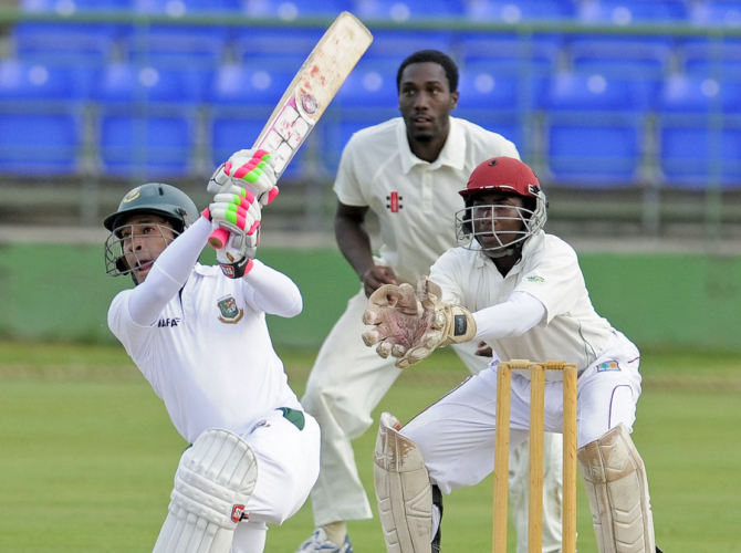 Bangladesh skipper Mushfiqur Rahim hits one over the top during the first day's play of the three-day practice match against St Kitts and Nevis at St Kitts on Saturday. PHOTO: WICB