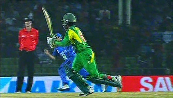 Mominul Haque hits a boundary on the leg side as Bangladesh take Afghanistan in their second match at Narayanganj Saturday. Photo: TV grab