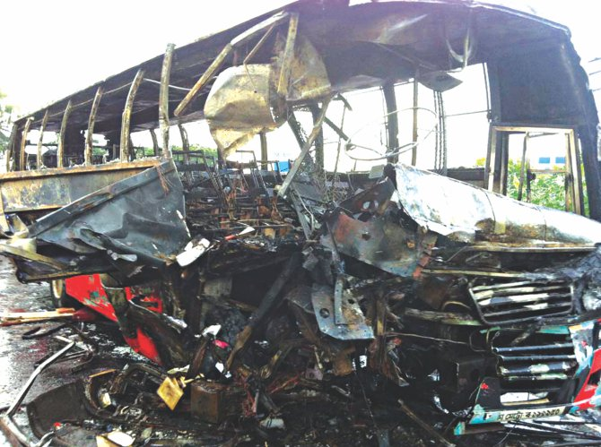 The burnt coach after it collided head on with a minibus near Shibpur upazila in Narsingdi on Dhaka-Sylhet highway yesterday and caught fire.  Photo: Star