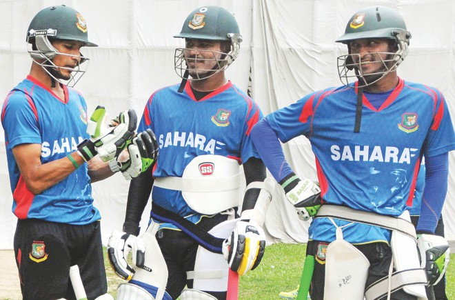 Bangladesh A skipper Nasir Hossain (L) shares some thoughts with teammates during their last practice session at Mirpur yesterday, on the eve of their departure for West Indies. PHOTO: STAR