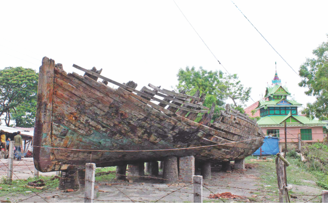 ARTEFACT IN RUINS: This 200-year-old wooden boat, kept under the open sky near the Buddhist temple in Kuakata sea beach since December last year, is getting damaged in sun and rain, thanks to the negligence of the department concerned. PHOTO: STAR