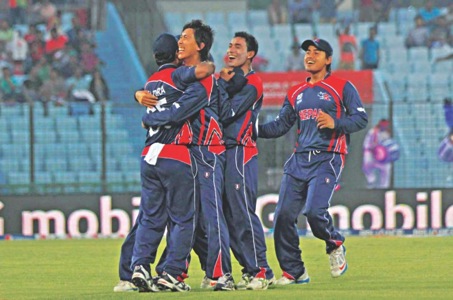 Nepal's medium pacer Jitendra Mukhiya (L) celebrates taking a wicket against Afghanistan during their ICC World T20 match at the Zohur Ahmed Chowdhury Stadium in Chittagong yesterday. Photo: Anurup Kanti Das