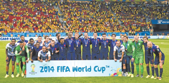 The Netherlands pose for a team photograph after finishing third in the World Cup by beating Brazil in Brasilia on Saturday. PHOTO: GETTY IMAGES