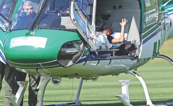 This handout photo shows Brazil superstar Neymar lying in a medical helicopter at the team's Granja Comary training centre in Teresopolis on Saturday. PHOTO: GETTY IMAGES