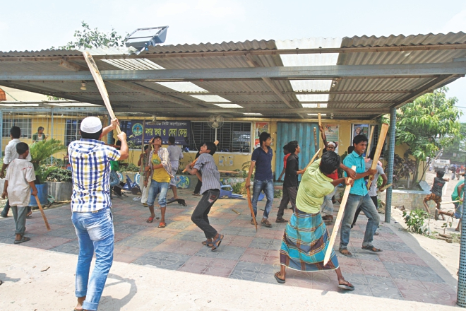 Angry locals vandalise an office of Nur Hossain. Photo: Star