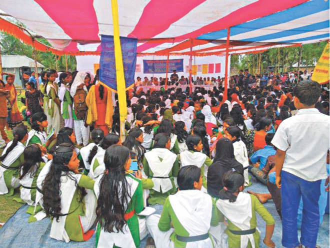 Schoolchildren attend a programme organised by NGO Udayankur Seba Sangstha on the playground of Polashbari Parashmoni High School in Nilphamari Sadar upazila during their class hours yesterday.  PHOTO: STAR