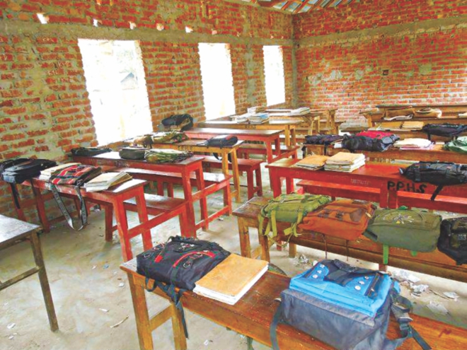 The room of Class IX of Parashmoni High School lies empty as the students were asked to join the programme, leaving schoolbags and books there. PHOTO: STAR
