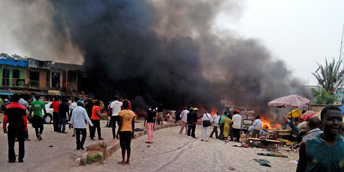 Smoke rises after a bomb blast at a bus terminal in Jos, Nigeria, Tuesday. Photo: AP