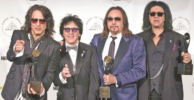 Kiss accepted their awards without their trademark face paints: (L-R) Paul Stanley, Peter Criss, Ace Frehley and Gene Simmons. Photo Courtesy: BBC