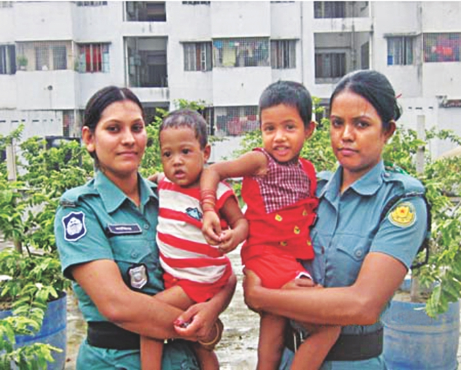 Four-year-old Mim, right, and her two-year-old brother Arif are being looked after by female police members at the Victim Support Centre of DMP in Tejgaon. The young siblings lost their parents recently.  Photo: Courtesy