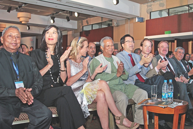 Nobel Laureate Muhammad Yunus, fourth from left, and Kerry Kennedy, president of Robert F Kennedy Centre for Justice and Human Rights, third from left, clap during an event to mark Social Business Day, at Radisson Hotel in Dhaka yesterday.  Photo: Star