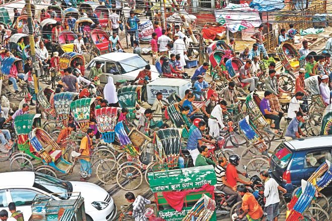 Numerous rickshaws moving haphazardly clog the road under the Khilgaon flyover in the capital on the second day of Ramadan yesterday. In the month leading to Eid-ul-Fitr, the number of rickshaws increases on Dhaka streets. Many poor people from different other districts come to the city to make some bucks by pulling rickshaws ahead of the festival. Photo: Sk Enamul Haq