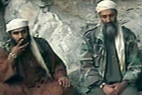 Abu Ghaith, left, with Osama bin Laden, in a video from after the September 11 attacks. This photo is taken from The New York Times.