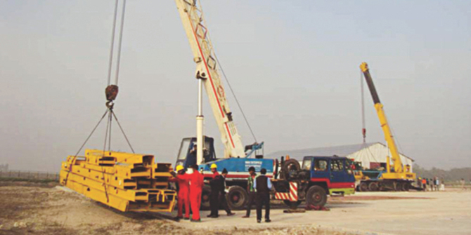 In this file photo, drilling equipment are seen kept at the prospective gas and oil site at Mubarakpur in Pabna district.