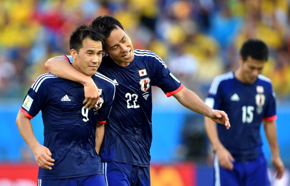 Shinji Okazaki (L) of Japan celebrates scoring his team's first goal with his teammate Maya Yoshida during the 2014 FIFA World Cup Brazil Group C match between Japan and Colombia at Arena Pantanal on June 24, 2014 in Cuiaba, Brazil. Photo: Getty Images