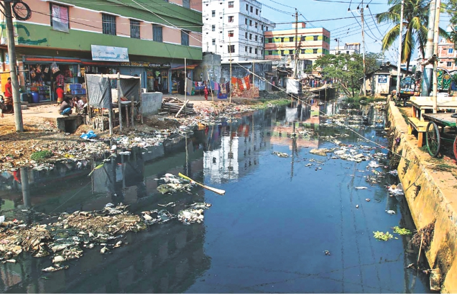 One glance at Chittagong city's Maittailla Khal, as in here in Khalpar Pocketgate, is enough to realise the indifference of the locals and the city corporation in keeping it clean and free from encroachment. The photo was taken recently. Photo: Anurup Kanti Das