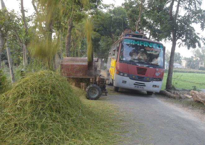 A threshing machine, paddy stalks and straw occupy a portion of Lalmonirhat-Hatibandha road at Boderhat in Hatibandha upazila under Lalmonirhat district, causing hindrance to vehicular movement and posing threat of accidents any time. PHOTO: STAR