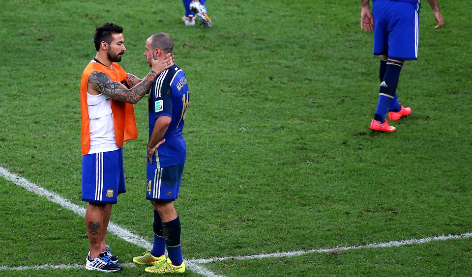 Ezequiel Lavezzi of Argentina consoles teammate Javier Mascherano after being defeated by Germany 1-0 in extra time during their World Cup final match with Germany on July 13, 2014 in Rio de Janeiro, Brazil. Photo: Getty Images