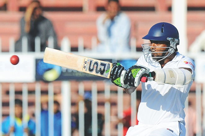 Sri Lanka batsman Dilruwan Perera plays the pull on way to scoring 95 on debut on the second day of the third Test against Pakistan at the Sharjah International Cricket Stadium yesterday. PHOTO: AFP