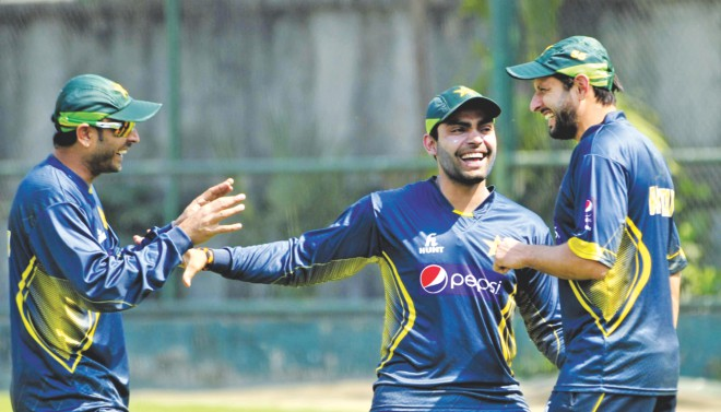 Pakistan's two main batting forces, Shahid Afridi (R) and Umar Akmal (C), are in jovial mood as they joke with left-arm spinner Abdur Rehman during practice at the Academy Ground in Mirpur yesterday. They will however be down to the serious business of retaining their Asia Cup title when they take on Sri Lanka in the final today. PHOTO: Firoz Ahmed