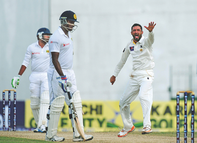 Pakistan pacer Junaid Khan (R) successfully appeals for an lbw decision against Sri Lanka's Dilruwan Perera on the first day of the second Test at the Sinhalese Sports Club ground in Colombo yesterday. PHOTO: AFP