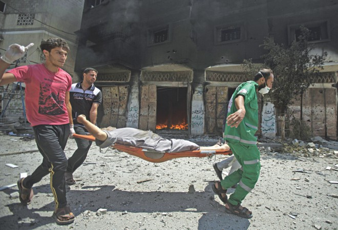 At least 87 people were killed and nearly 500 wounded in Israeli shelling of Gaza's northeastern Shejaiya district overnight, medics said.  Photo: AFP