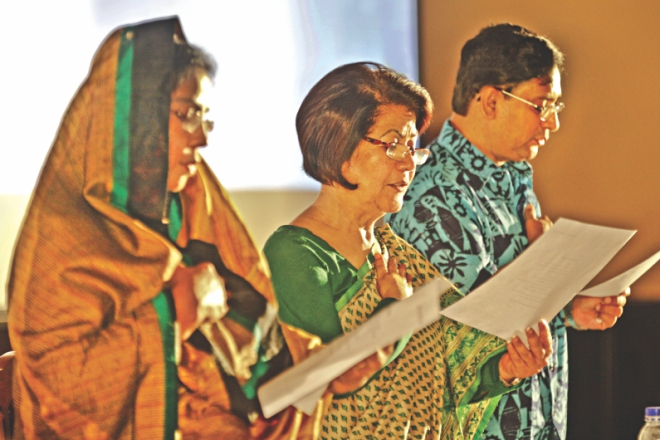 Meher Afroze Chumki, Rokia Afzal Rahman, and Rizwan-ul-Alam read out the oath. PHOTO: STAR