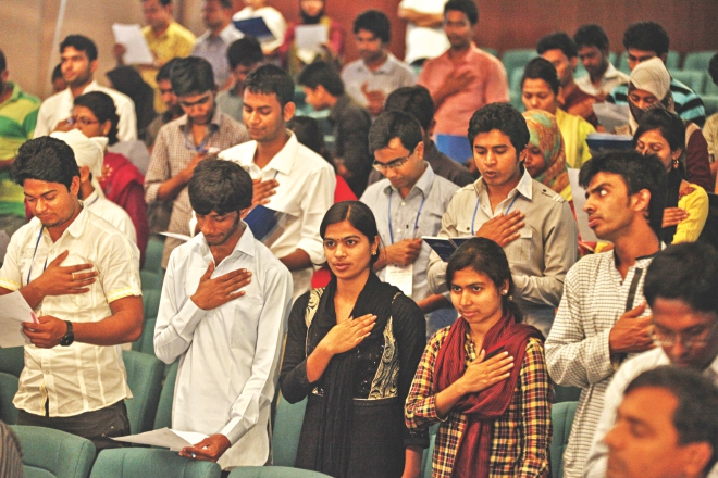 Participants take an oath to fight corruption at the opening of a two-day debate hosted by Transparency International, Bangladesh at the capital's Bangla Academy yesterday.  PHOTO: STAR